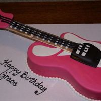 Pink Guitar   body of guitar cake covered in mmf, neck cardboard covered in silver wrap