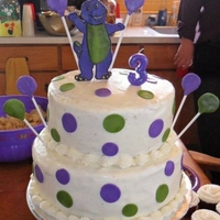 Barney Cake double layer 10inch double layer 8inch, buttercream frosting, fondant Barney, dots and balloons.