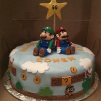 Super Mario Bros Loved making the 3D Mario and Luigi from fondant, and all the other characters and design elements on the side of the cake. The birhday boy...