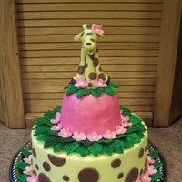 Suprise Giraffe Cake! I posted a pic a few weeks ago of just the giraffe topper , here is the finished cake. I made this for my daughters birthday since she is a...