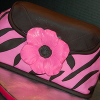 Pink And Black Zebra Stripe Purse With Anemone Flower This is my second attempt at a purse cake and had some carving issues. My cake was just way too crumbly so I didn't get to carve as...