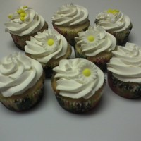 Pineapple Pineapple cupcakes with homemade whipped cream frosting.