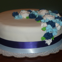 White, Navy Blue, Light Blue Wedding Cake This was a practice cake for a wedding cake i'll be making. Chocolate Cake with buttercream and MMF. Navy Blue & Light Blue satin...