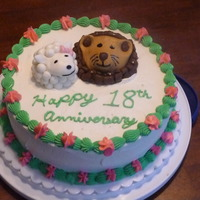 Lion And Lamb Anniversary Cake Chocolate cake with Buttercream frosting. Lion and Lamb made from MMF.