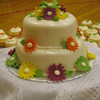 Daisies Strawberry-filled lemon cake with lemon buttercream and fondant. The daisies almost perfectly match the colors in the brides bouquet and...