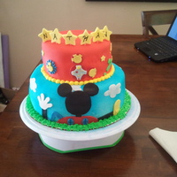 Mickey Mouse Club House Cake This cake is marble with strawberry filling covered in fondant. This is actually my second club house cake but this time I added the stars...