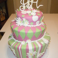 Crazy Daisy Green and pink topsy turvy cake with gum paste daisies.