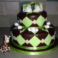 Brown & Green Shower Cake With Giraffe Made this for co-worker of my husband. Bottom is apple cinnamon with brown sugar buttercream, top is yellow with chocolate. Got the shoe...