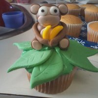 Monkey Cupcakes I make 12 of these for my nephews pre-school. I made each monkey by hand with MMF and added some candy bananas. Took me roughly 6 hours...