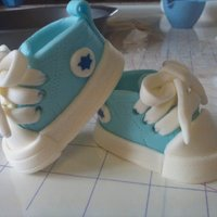Fondant Baby Converse Booties These are my first time making these and they turned out very adorable. I used marshmallow fondant. They were very fun and easy to make...