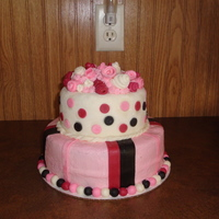Girly Birthday Cake =] 8 inch with 6 inch on top, both chocolate cake with peanut butter cup filling.