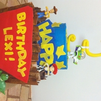 Toy Story white cake with vanilla butter cream and fudge cake with chocolate butter cream. gumpaste and fondant accents!