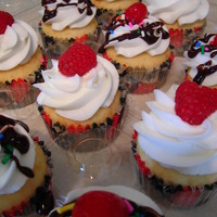 Berries And Cherries Vanilla raspberry cupcakes - raspberry cream cheese filling, vanilla buttercream, and a fresh raspberry on top. Vanilla sundae cupcakes -...