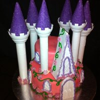 2 Tier Princess Castle Cake i used portions of the wiltons romantic castle kit to make this cake. its chocolate cake with chocolate buttercream. covered in pink...