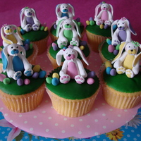 Happy Easter Cupcakes with green icing and bunny's and eggs made from fondant.