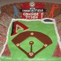 Diamondbacks Cake This was a birthday cake for brothers. The stadium is made out of cocoa krispies, the field is cake covered with fondant. The score board...