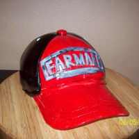 Farmall Cap  I made this Farmall cap for my father-in-law for his birthday. It is a chocolate cake with peanut butter butter cream. It is covered in MMF...