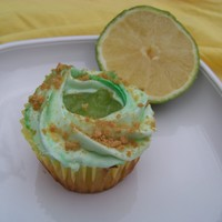 Very Key Lime Cupcakes a tart lime cupcake with keylime pie filling finished with a swirl of lime butter cream dusted with gram crumbs