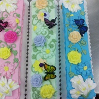 Spring Bar Cakes 3 bar cakes I iced in buttercream and flowers are all in buttercream. Very fresh and springy.