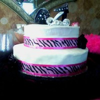 Zebra Cake Vanilla buttercream frosted cake. Gumpaste high heel. The last picture is the smash cake and has rosettes on it.. that one didn't turn...