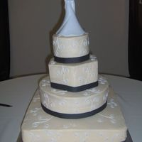 Cindy And Kie's Wedding Cake   I was not too happy with the way the white topper looked on the ivory cake but that is what the bride wanted so that is what I did.