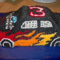 Mike's Car Cake   My 12 year old son decorated this cake when I was at work one day. I thought he did a good job.