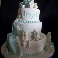 Fondant Animals Shower Cake This is a three tier baby shower cake. First tier was a vanilla bean cake filled with cream cheese and strawberry filling. Second was...
