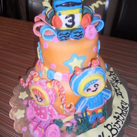 ***umi Zoomi*** This cake was made with Pettinice fondant that was colored using Wilton Color Mist.Figures were modeling choc. covered RKT.I really enjoyed...