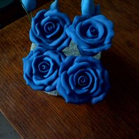"Carolina Blue Modeling Chocolate Roses One of my good friends wants a wedding cake with ""Carolina blue"" roses, luckily she gave me a piece of fabric to match colors to..."