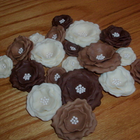 Modeling Chocolate Wild Roses I was asked to recreate some silk flowers for a bride that she found on etsy in ivory, latte, and brown. All are made from modeling...