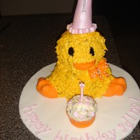 Baby Chick My first attempt at a 3D cake. Made this for my daughter's first birthday. I used her favorite stuff animal and her birthday hat as...