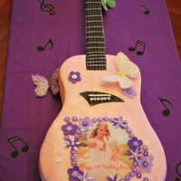 Taylor Swift Birthday Cake This was a Taylor Swift Guitar Birthday Cake for my 6 year old niece. White Cake with Strawberrry filling that was cut and shaped. Covered...