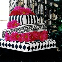 Black And White Hot Pink Gerber Daisies Black and White topsy turvy Wedding Cake