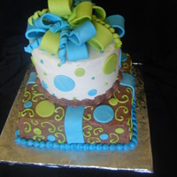 Birthday Cake Brown Blue Green and white, buttercream with fondat accents and bow.