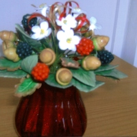 Autumn Arrangment my first sugar flower arrangment made, consists of bramble flowers, acorns, oak leaves, bramble leaves, blackberries and ribbons.