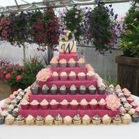 "Cupcake Wedding Pyramid cupcake tower/pyramid shown with 200 cupcakes! Each cupcake is wrapped with a self made wrapper stamped with a ""W"" for the..."