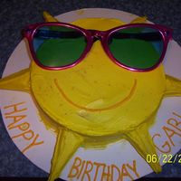 Sunny Sunshine! This was a fun cake to make! Except, i forgot to put foil on my cardboard so the grease from the buttercream wouldn't soak through. Oh...