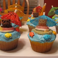 "A Day At The Beach Cupcakes Made for our school's Spring Fair which had a ""Day at the Beach"" theme.teddy grahams, gummy rings, cocktail umbrellas"