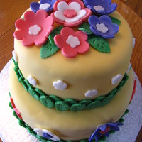 Spring Flowers Made for a Dessert Auction. Vanilla cake with butter cream icing, covered with fondant.