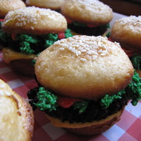 Hamburger Cupcakes vanilla cupcakes sliced in half, chocolate cupcakes cut for patties, green icing with coconut for lettuce/relish and red and yellow BC for...