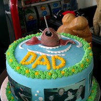 Fishing Fathers Day Cake A fish been hooked out of the water, with edible pictures of my dad, my sisters and his grand children for fathers day. cake is carrot cake...