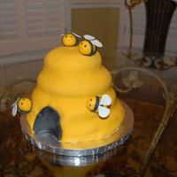 "Beehive Cake This cake was made form 4 single tiers (8"", 7"", 6"", and 5""). I started with two 8"" and 2 6"" tiers stacked..."
