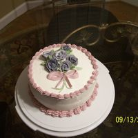 Birthday Cake This was my first birthday cake I made after my Wilton course. The cake was a strawberry cake with vanilla buttercream filling. All...