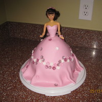 "Pink Barbie Cake My first Barbie cake. Cake was a yellow cake using the wilton wonder pan with an additional 3"" tall 8""round cake under it (my..."