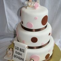 Baptism Cake A baptism cake I made for a friend - she wanted an angel theme along with a cross and pink and brown polk a dots. I hope she liked it.