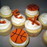 Basketball Cupcakes Doctored box cake mix with canned (gross) frosting. Basketballs & letters are fondant with chocolate writing - they're supposed to...