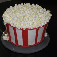 Popcorn Fun cake to make! BC with fondant accents and mini marshmallows for popcorn. Vanilla cake with chocolate chip cookie dough filling - it got...