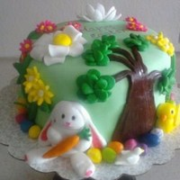 Happy Easter! Torted strawberry and banana layers w/ strawberry cream filling. Covered in fondant w/ fondant decorations.