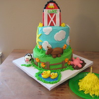Barnyard 1St Birthday Cake for my son's 1st birthday. Got lots of inspiration from CC. RKT barn covered in fondant. All fondant decorations. Frosted in BC...