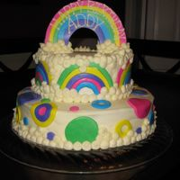 Rainbows And Dots For my neice's 12th birthday. Buttercream with MMF dots and rainbows.